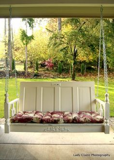 Recycled doors become the perfect porch swing