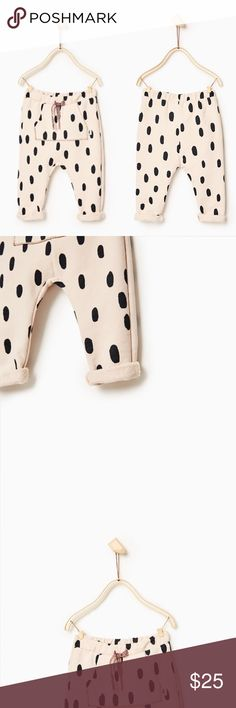 Jogger Bottoms Polka Dot Zara Baby Patterned Baby Joggers.  Trousers with adjustable contrasting cord and stretch waist. Pouch pocket with shiny topstitching and appliqué detail. Turn-up hem Zara Bottoms Sweatpants & Joggers