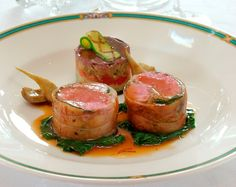 Roasted loin of lamb stuffed with aubergine confit and grilled pine kernels,