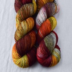 Shades of gray with red and yellow bring to mind armor, smoke, and flickering flames. This colorway is a Babette: every skein and every batch is a bit different Daily Fiber, Fingering Yarn, Joan Of Arc, Sport Weight Yarn, Yarn Stash, Neat And Tidy, My Cup Of Tea, Finger Weights, Crochet Yarn