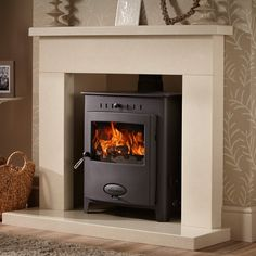Solid Fuel (wood etc) wood burner for lounge - heats water, room and also up to 17 rads - about £2000 Aarrow Stratford Eco 25 HE Multi-fuel / Woodburning Boiler Stove