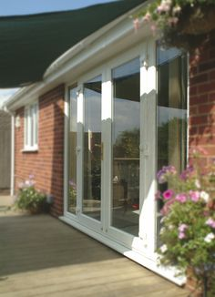Custom made and installed by Weatherglaze Designs Lovely french doors with side panels