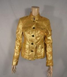Desperate Housewives        This unique item is from the television show Desperate Housewives.    This is Gabrielle Solis' screen worn wardrobe item.        Season:  Six    Episode Title:  623         Items: Button-Front Jacket      Wardrobe Details          JACKET   Brand: Tory Burch      Size: N/A (Approximate Size Small)      Material: Leather      Color: Metallic Gold      Condition: Good Condition      Original Retail Price: N/A