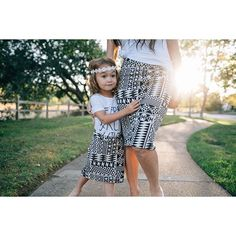 Trying hard to not die over the mommy daughter matching picture Shelley Bee Originals makes the cutest mommy/daughter skirts!!!