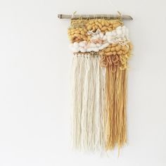 A beautiful little weave loaded with fluffy roving in butterscotch and cream…