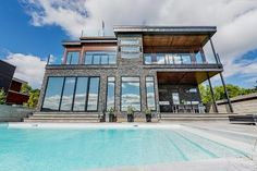 Talk about a dream home! This is a full custom Timber Block home. Keep posted, we will show you more (including the interior)! www.timberblock.com