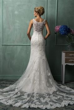 Amelia Sposa Gracie 2014 is a Charming Alencon Lace on Tulle Over Satin Fit & Flare Mermaid Gown with an Illusion Beaded Lace Scoop Neckline Over Sweetheart Interior, Beaded Lace Tank Straps, Crystal Beaded Lace Fitted Bodice Past Hips, Lightly Padded
