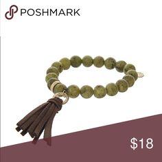 Green lemon stone w/ brown tassel stretch bracelet Green lemon stone w/ brown tassel stretch bracelet Jewelry Bracelets