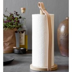 Hands On isa stylishleather and oak kitchen towel holder designed by the Danish company By Wirth. The kitchen roll holder is made from oak with a leather strap holding the roll in on the side and adding to the styling.Size: Height: 31 cm, Diameter: 12.5