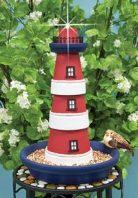 Terra cotta lighthouse.  3 clay pots, one small saucer for top, one large saucer…