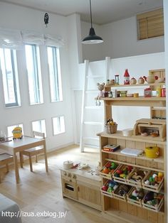 Playroom. Lovely space, particularly enjoy the market area. Love the simple combination of pale wood and white walls.