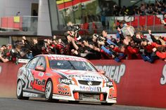 Garth Tander driver of the No.2 Holden Racing Team Holden is congratulated by his team after he and teammate Will Davison won the Bathurst 1000. (Getty Images)