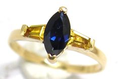 "Marquis Blue Sapphire Dress Ring with Yellow Sapphire Shoulders custom made by Australian master Jeweller Peter Kumskov ""My Own Jeweller Direct"" in Brisbane."