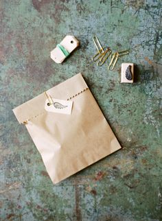 How to wrap a wedding favor: http://www.stylemepretty.com/living/2014/10/14/the-best-gift-wrapping-tool-ever/ | Photography: White Loft Studio - http://whiteloftstudio.com/