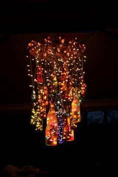 An outdoor chandelier with bottles and lights!