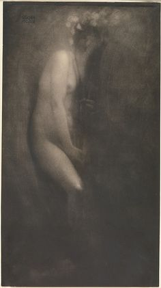 "Edward Jean Steichen, Bivange, Luxembourg, (1879-1973). American photographer, painter, and art gallery and museum curator. ""Figure with Iris"" (1902). Direct carbon print photograph. 340x188mm. Alfred Stieglitz Collection."