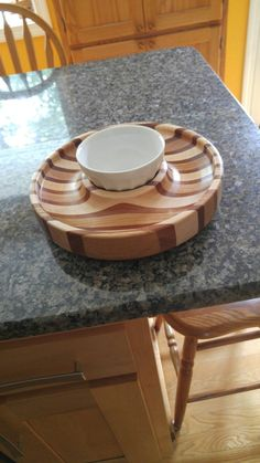 Chip and dip. Oak, Maple and Mahogany. 12 in Diameter x 2 in thick. Turned by Joe Oliver.