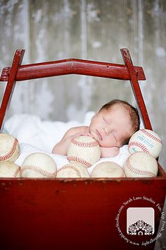 BABY BOY WITH SPORTS BALLS AROUND HIM - could do with computer chips or something