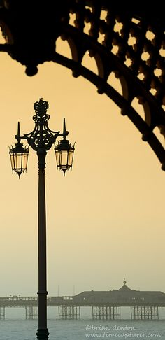 Brighton's Madeira Walk and Victorian Lamppost and the Palace Pier in the background, Sussex, England