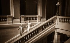Beautiful bride and groom in antique fashion going down the Capitol steps in Madison Wisconsin.  Www.reillyimages.com