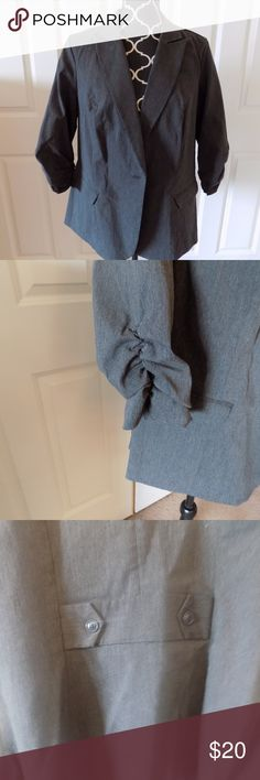 Torrid Gray Blazer Torrid gray blazer with ruched sleeves.  Lots of spandex, so it's very comfortable to wear.  Only worn once. torrid Jackets & Coats Blazers