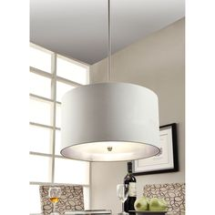 Bring a touch of class to any room in your home with the silver foil lining pendant, featuring a brushed nickel finish. This effulgent fixture also highlights a warm, ivory linen shade with a metallic silver lining.