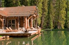rustic cabin with dive in pond! traditional exterior by Highline Partners, Ltd