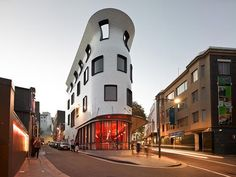 Architectural restaurant, offices and rooftop garden bar in Sydney - surely inspired by Gaudi