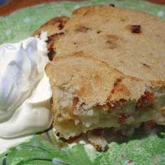 Lithuanian Kugelis With Sour Cream  (Bulvių Plokštainis/Potato Cake)
