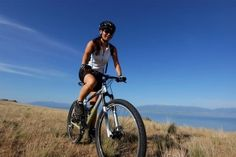 Woman Bike Riding For Fitness