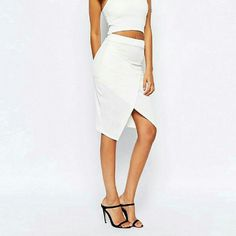 ASOS White Wrap Midi Skirt Textured stretch Envelope skirt by Boohoo from ASOS.  95% Polyester,  5% Elastane.  Brand new with tags in original packaging. ASOS Skirts Midi