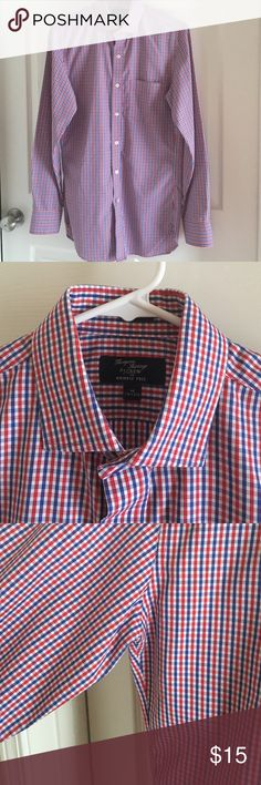 Red and blue check j crew men's wrinkle free shirt Great red and blue check j crew men's dress shirt. Missing button on right sleeve but has button attached to fix it. Price reflected J. Crew Shirts Dress Shirts