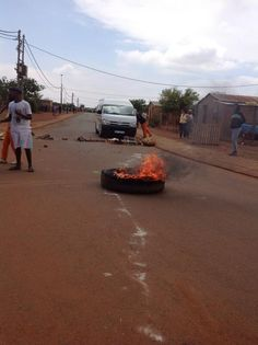 """"""" Tyres being set alight ahead of meeting at neighbouring Simunye Township."""