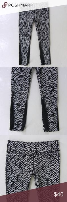 """NIKE Epic Lux Printed Crops Capri Crop Pants LT L NIKE Epic Lux Printed Crops in a black and white print.  Style #698864-010, sold out online and in stores, retail is $105.00.   Wide flat elastic waist, small key pocket, exterior zip pocket at lower back, silver reflective Nike swoosh logo, interior drawstring waist, stylish sheer mesh insets on the calves, lots of stretch.  77% nylon, 23% spandex, machine wash.  Tagged a Size LT, please check measurements to determine fit.  30-36"""" waist…"""