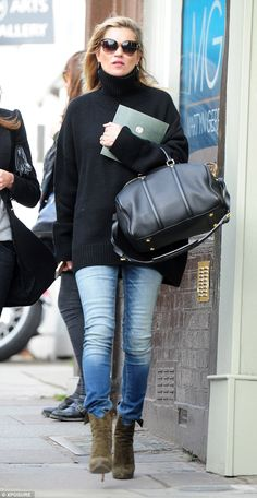 Off-duty chic: Kate Moss managed to cut a stylish figure when she stepped out for a low-key lunch date in Hampstead on Tuesday afternoon