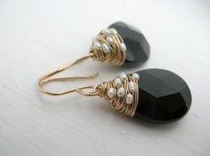 I love the tiny pearls (or beads) laced in the wire.  Fresh Water Pearl Woven Black Onyx Earring. $85.00, via Etsy.