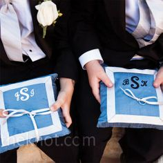 The ring bearers carried blue dupioni silk pillows made of material from the bridesmaid dresses.