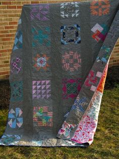 Colorful quilt blocks on a grey background