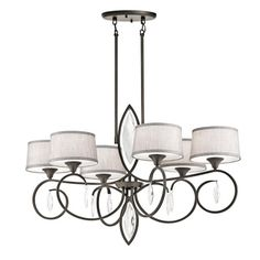 Casilda Oval 6 Light Chandelier brings an updated traditional style with stunning cut and polished faceted crystals. Finished in Olde Bronze our Chandelier showcases crystals dazzling while the Silver Beige fabric shades and satin etched diffusers complete the look.