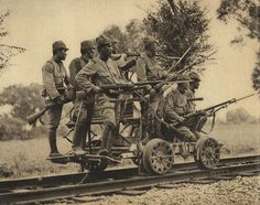 Soldiers of the Imperial Japanese Army with Arisaka Type 38 rifles are photographed on a rail hand cart during the invasion of China en route to the Battle of Shanghai. Zhejiang Province, People's Republic of China. History Online, World History, Military Photos, Military History, Imperial Army, Army Soldier, Panzer, World War Two, Wwii