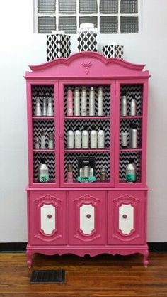 This would be a pretty way to display your perfume collection.  Maybe remove the shelves as they are and make them custom so they are a tad closer together.  Leaving the doors on, or removing them for a whole new look.