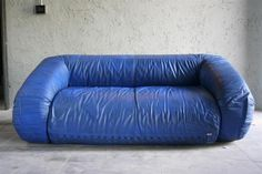 A two-seater sofa bed with a steel roller structure. It features polyurethane padding with acrylic fibers thermally welded with protective fabric. The mattress is also made of polyurethane. There is a blue removable leather cover.