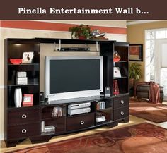 Pinella Entertainment Wall by Ashley Furniture. Signature Design By FurnitureXO Pinella Entertainment Wall W403-24(2)-25-60. The clean look of sophisticated style comes to life with the rich finish and contemporary accents of the beautifully designed Pinella Entertainment Wall by Signature Design. Bathed in a rich merlot finish, this entertainment wall is perfectly accented with silver color finished ring pull hardware and glass shelves within the lighted piers to create an overall...