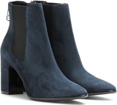 Switch your signature black boots for a chic navy pair.