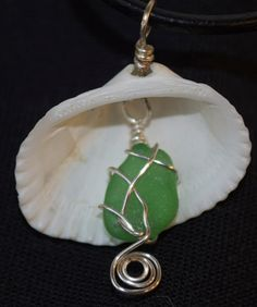 Wire Wrapped Green Sea Glass in Cockle Shell Necklace by RosiesArtSoup on Etsy