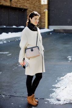 White and black with tan leather boots #CarolineIssa #streetstyle #fashionweek