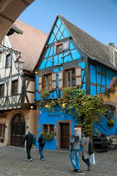France, Alsace, Riquewihr, Haut-Rhin, Typical Colorful Half-timbered Houses - eStock