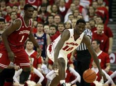 Feb 25, 2014; Madison, WI, USA; Wisconsin Badgers forward Nigel Hayes (10) looks for the loose ball as Indiana Hoosiers forward Noah Vonleh ...  -- #IUCollegeBasketball