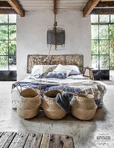 Pretty and practical- baskets at the foot of the bed.