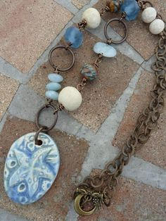 Day at the Beach Blue Ceramic Sea Star with by GraceElements,/ Love the dark metal. What would this look like with beige and rust and green stones?